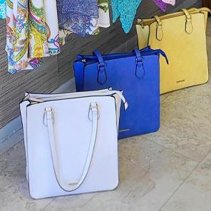large white, blue and yellow handbag
