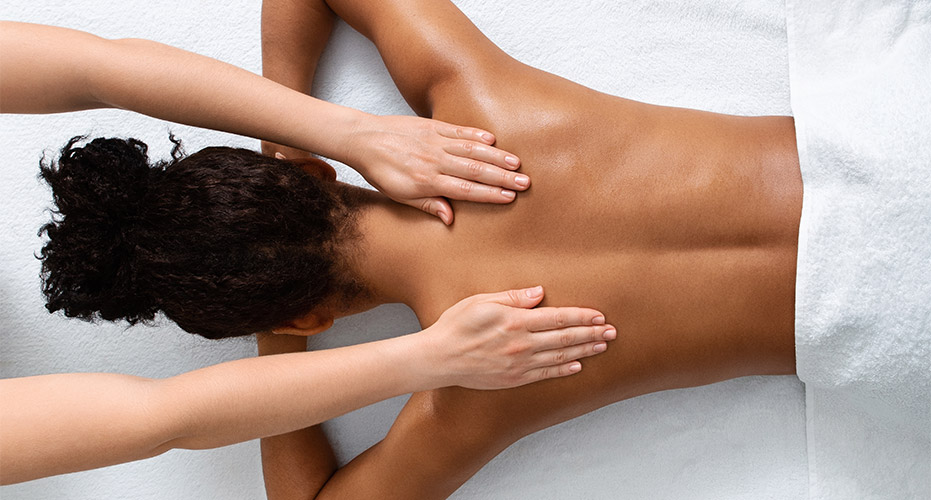 woman receiving a professional back massage in Englewood FL