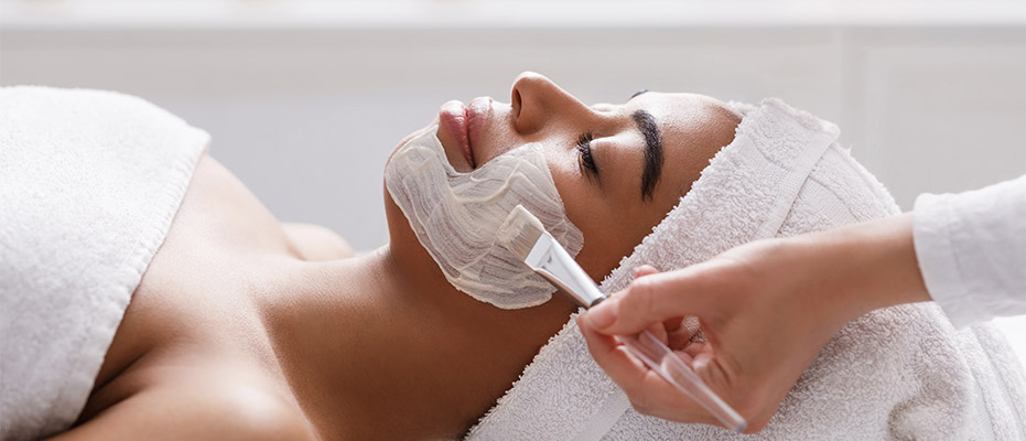 woman receiving skin treatment from a skilled esthetician in Englewood FL
